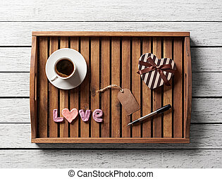 Valentine served with cup of coffee, gift box, word love and...