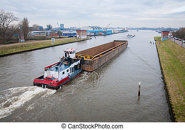 barge is on the canals in Amsterdam