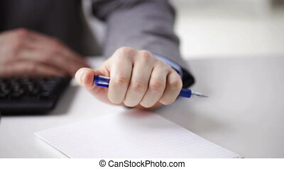 close up of businessman hands with notepad
