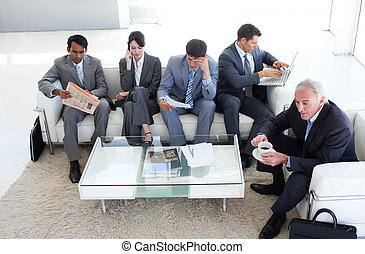A diverse business people sitting in a waiting room