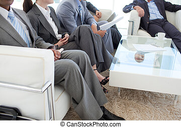 Business people in a waiting room before a job interview