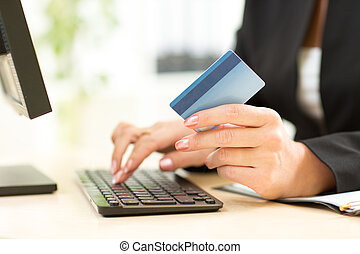 Business Woman holding Credit Card for Online Payment