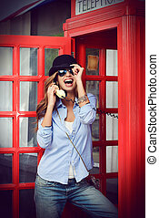 old town - Pretty young woman talking on the phone in...