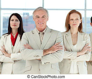 Portrait of a serious business team with folded arms