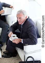 Businessman drinking coffee and waiting for a job interview