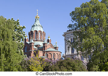 uspenski cathedral in helsinki with purple and white flowering trees