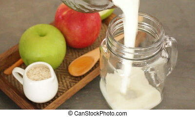 Apple with oats and honey smoothie in small jar