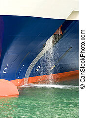 Flushing - The bow of a big passenger ship, with water...