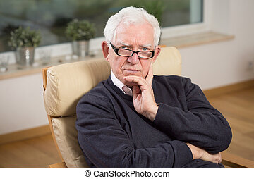 Retired man sitting on the chair