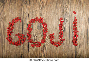 Goji berry  - goji berries on a rustic wooden background