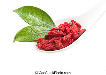 Goji berry  - Spoon with Group of Goji berry on the white