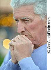 Senior man thinking about something - Close-up portrait of a...