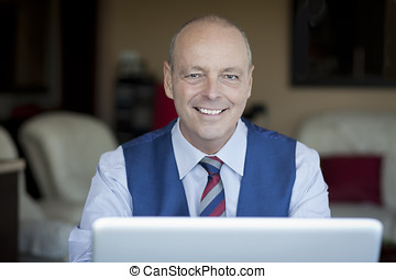 Mature Businessman Smiling - Office Interior, Home Interior,...