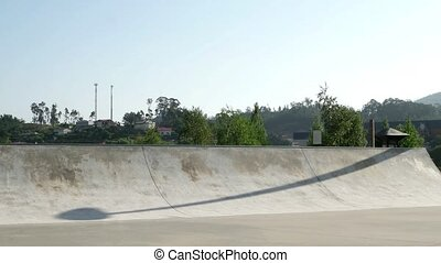 Skateboarder performing a grind - Skateboarder performing a...
