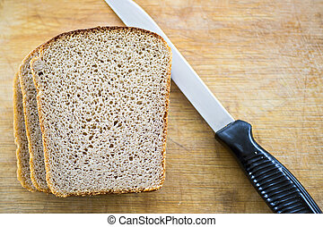 Bread and knife on breadboard
