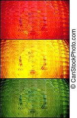 Red, yellow, green spotlight traffic light as background