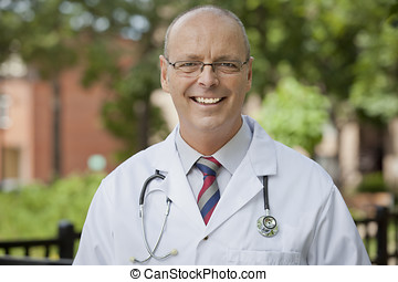 Portrait Of A Doctor Smiling - Apron, Outdoors, Healthcare...