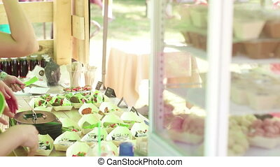 Raw food festival - Caucasian woman selling raw food in the...
