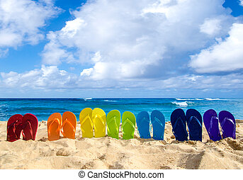 Colorful flip flops on the sandy beach - Colorfull flip...