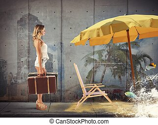 Walking toward the holidays - Girl with suitcases walking...