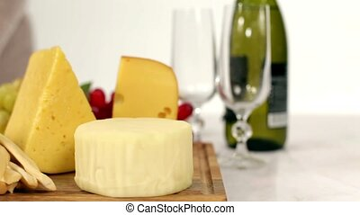 Cheese dinner - Dolly. Woman prepares a delicious romantic...
