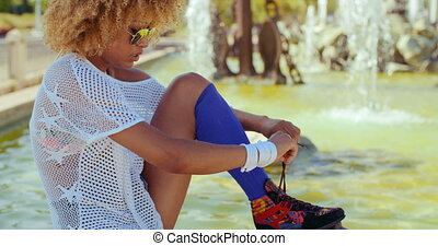 Girl Tying Shoelaces in Her Roller Skates - Slow Motion...