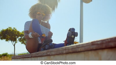 Girl Puting Her Roller Skates - Slow Motion Video of Girl...