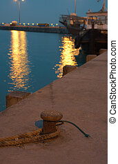 Harbor at night - Mooring ring on the pier of the Al waker...
