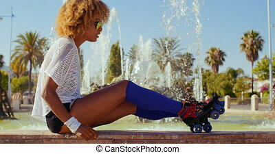Sexy Girl Adjusting Her Roller Skates - Slow Motion Video of...