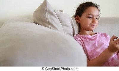Smiling girl using - Girl using phone