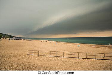 Beach Cloud Scape - Storm clouds over lake Michigan beach