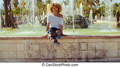 Happy Sexy Girl Sitting on Fountains Wall - Slow Motion...