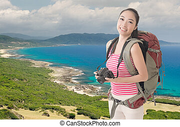 backpacker with camera - Happy smiling Asian young female...