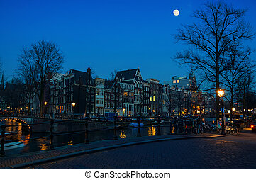 Moon over Amsterdam, Netherlands canals and bridges - Full...