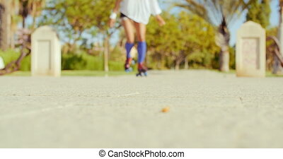 Low Angle Video of a Girl Riding Roller Skates - Slow Molina...