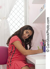 Studing - Child in her desk studing for school.
