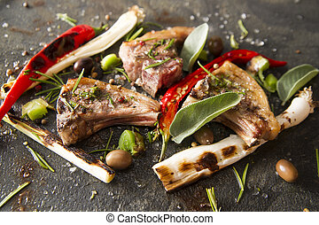 Lamb chops cooked on the grill with leek and red pepper