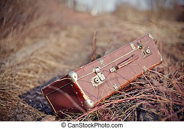 Old fashioned forgotten a suitcase, lie forgotten in a faded...