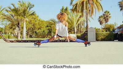 Sexy Flexible Girl Doing Splits on Roller Skates in Slow...