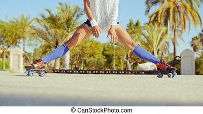 Sexy Flexible Girl Doing Splits on Roller Skates in Exotic...