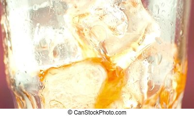 close-up of pouring fresh coke with ice cubes, summer time...