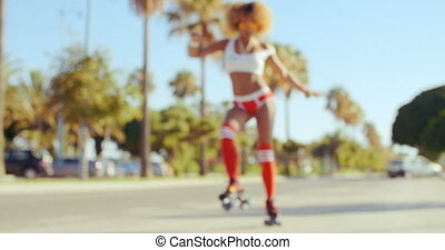 Young Woman on Her Roller Skates - Young Woman Practice on...