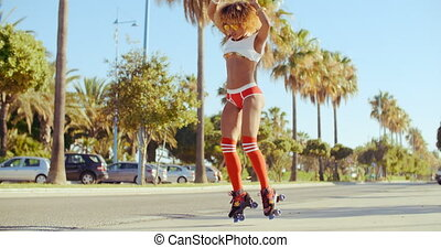 Girl With Afro Haircut Dancing On Roller Skates in Tropical...