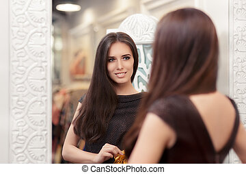 Lovely Girl Looking in the Mirror - Portrait of a young...