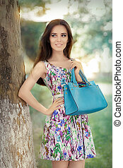 Woman in Floral Dress Holding Purse - Stunning trendy girl...