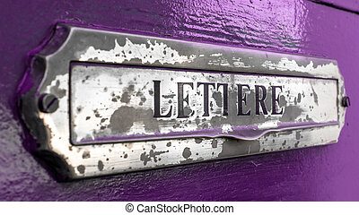 Postbox - An old letter box of a door painted of purple.