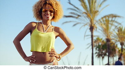 Beautiful Smilng Girl With Afro Haircut Standing With Her...