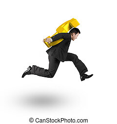 Jumping businessman carrying 3D golden dollar sign, isolated...