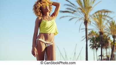 Sexy Girl with Afro Haircut Taking Sun Light at Exotic...