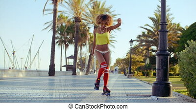 Sexy Roller Girl Skating on Exotic Promenade - Sexy Roller...
